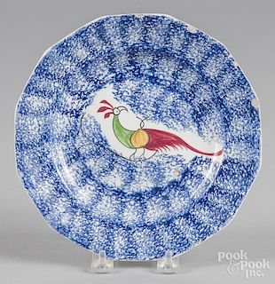 Blue spatter plate with peafowl decoration, 8 3/8'' dia.