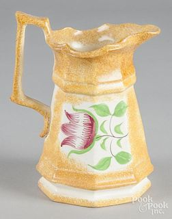 Yellow spatter pitcher with tulip decoration, 8 1/2'' h.