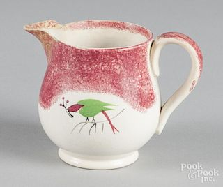 Red spatter creamer with parrot decoration, 4'' h.