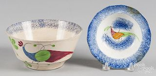 Two blue spatter bowls with peafowl decoration, 1'' h., 5 1/4'' dia. and 3'' h., 6 1/4'' dia.