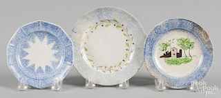 Three blue spatter toddy plates with fort, star, and wreath decoration