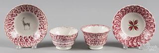 Red sponge spatter cup and saucer with red flower decoration, together with another cup and saucer