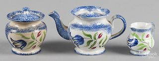 Miniature blue spatter teapot, sugar, and creamer with blue tulip decoration, teapot - 3 1/2'' h.