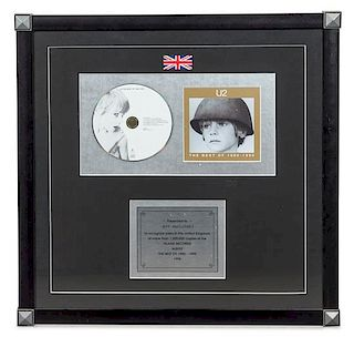 A U2: The Best of 1980-1990 1.2 Million UK Copies Sold Presentation Album 18 3/4 x 18 3/4 inches.