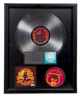 A Kanye West: The College Dropout RIAA Certified 2x Platinum Presentation Album 21 1/2 x 17 1/2 inches.