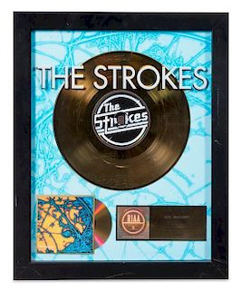 A The Strokes: Is This It? RIAA Certified Gold Presentation Album 22 1/4 x 18 1/4 inches.