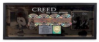 An Autographed Creed: My Own Prison RIAA Certified 4x Platinum Presentation Album 12 x 31 inches.