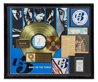 An Us 3: Hand on the Torch RIAA Certified Gold Persentation Album 22 x 26 inches.