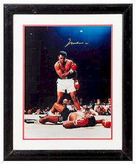 A Muhammad Ali Autographed Photo 19 x 15 inches visible.