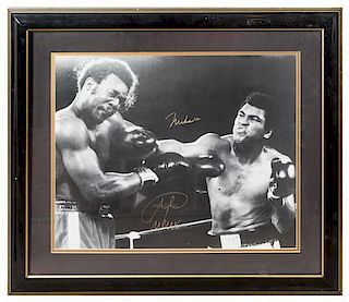 A Muhammad Ali & George Foreman Autographed Photo 23 x 27 inches overall.