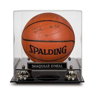 A Shaquille O'Neal Autographed Basketball height of display case 12 x width 11 x depth 12 inches.
