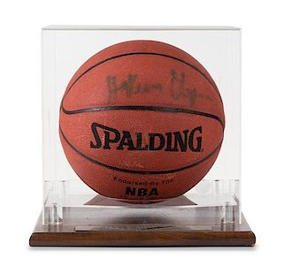 A Hakeem Olajuwon Autographed Basketball Height of display case 12 x width 11 1/2 x depth 12 inches.