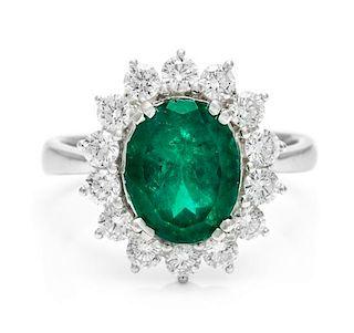 An 18 Karat White Gold, Emerald and Diamond Ring, 5.50 dwts.