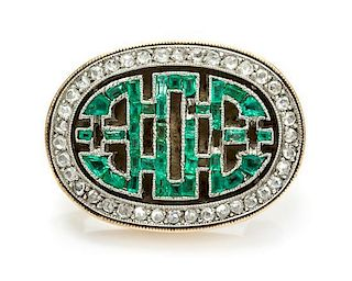 * A Platinum Topped Gold, Emerald and Diamond Pin, 4.70 dwts.
