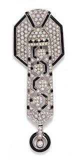 An 18 Karat White Gold, Diamond and Onyx Pendant/ Brooch, 14.70 dwts.