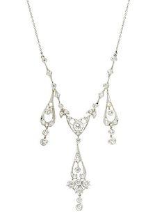 * An Edwardian Platinum and Diamond Necklace, 7.70 dwts.