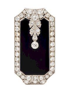 An Art Deco, Platinum, Diamond and Onyx Pendant/Clip Brooch, 11.00 dwts.