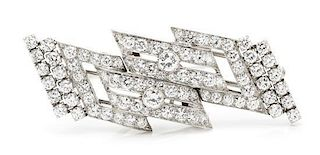 A Pair of Platinum and Diamond Dress Clips/Brooch, 12.00 dwts.