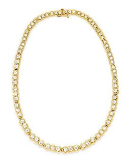 * A Graduated Yellow Gold and Diamond Necklace, 27.70 dwts.