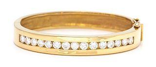 A Yellow Gold and Diamond Bangle Bracelet, 25.30 dwts.