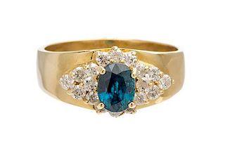 A 14 Karat Yellow Gold, Blue Topaz and Diamond Ring, 6.20 dwts.