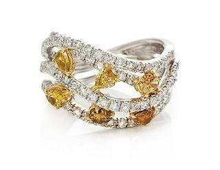 An 18 Karat White Gold, Colored Diamond and Diamond Ring, 5.40 dwts.