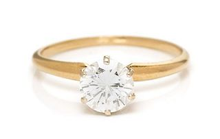 A 14 Karat Yellow Gold and Diamond Solitaire Ring, 1.30 dwts.