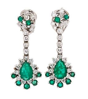* A Pair of White Gold, Emerald and Diamond Pendant Earclips, 7.20 dwts.