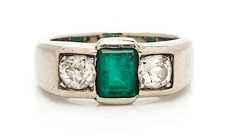 * A Platinum, Emerald and Diamond Ring, 6.00 dwts.