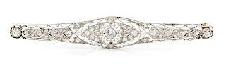 * A Platinum and Diamond Bar Brooch, 6.80 dwts.