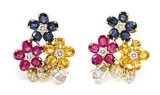 A Pair of Yellow Gold, Sapphire, Ruby and Diamond Floral Motif Earclips, 14.90 dwts.