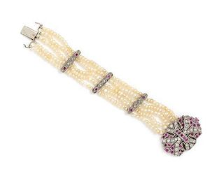 * A White Gold, Ruby, Diamond and Seed Pearl Multistrand Bracelet, 13.60 dwts.