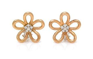 A Pair of Bicolor Gold and Diamond Flower Motif Earclips, 10.10 dwts.