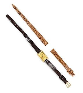 An 18 Karat Yellow Gold and Swiss Ingot Wristwatch, Corum,