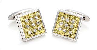 A Pair of 14 Karat White Gold, Yellow Sapphire and Diamond Cufflinks, 4.70 dwts.
