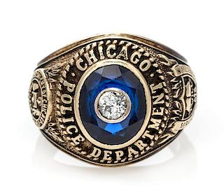 A 10 Karat Yellow Gold, Synthetic Sapphire and Diamond Chicago Police Department Ring, 9.20 dwts.