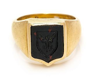 A 10 Karat Yellow Gold and Bloodstone Intaglio Crest Ring, 12.00 dwts