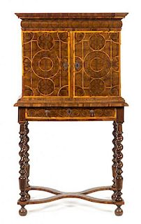 A William & Mary Oysterwood Cabinet on Stand Height 54 1/2 x width 29 1/2 x depth 18 1/4 inches.