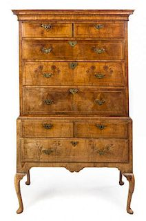 A George I Feather Banded Walnut Chest on Stand Height 69 x width 41 1/4 x depth 22 1/4 inches.