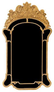 A George III Style Giltwood Mirror Height 67 3/4 x width 38 1/4 inches.