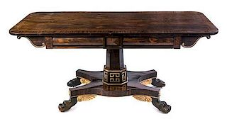 * A Regency Parcel Gilt Rosewood Center Table Height 30 x width 65 x depth 28 inches.