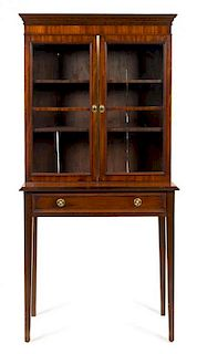 A Regency Mahogany Cabinet on Stand Height 64 1/2 x width 32 x depth 14 3/4 inches.