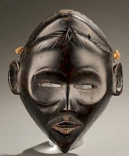 West African face mask, 20th century.