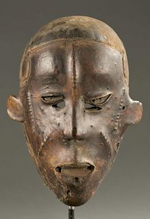 West African skin covered face mask, 20th c.