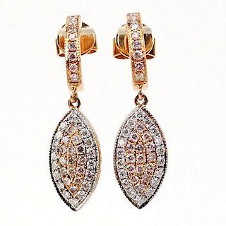 .40 Carat Natural Pink Diamond, .29 Carat Round Cut Diamond and 18 Karat Rose Gold Earrings