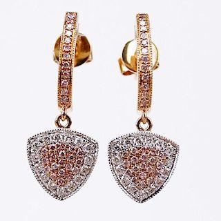 .18 Carat Natural Pink Diamond, .19 carat Round Cut Diamond and 18 Karat Rose Gold Earrings