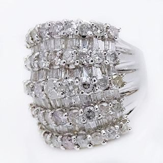 5.58 Carat Round Brilliant Cut and Tapered Baguette Diamond and 18 Karat White Gold Ring