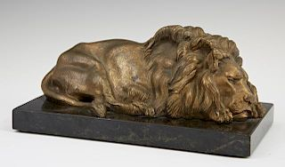 Gilt Bronze Sleeping Lion, 20th c., on a figured b