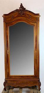 Louis XV style single door armoire in walnut.