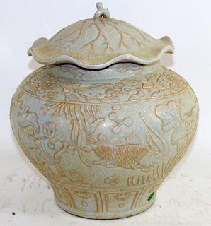 Chinese Celadon glazed lidded vase
